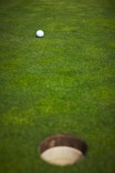 Free Single Golf Ball Beside The Hole Stock Image - 14225911