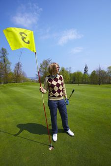Free Woman Holding A Flag On A Golf Course Royalty Free Stock Photo - 14225975