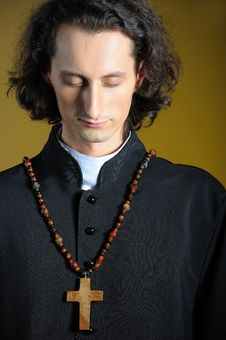 Praying Priest With Wooden Cross Stock Images