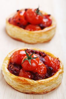 Tartlets With Ripe Tomatoes Royalty Free Stock Photography