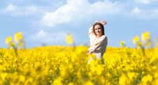 Happy Girl In Yellow Flowers Stock Photography