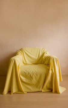 Free Armchair With Yellow Bed Sheet Stock Images - 14229234