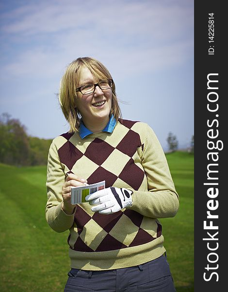 Golfer woman writing handicap