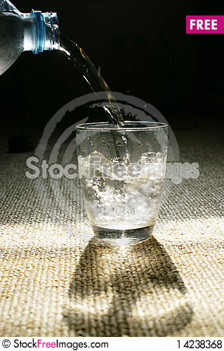 Water pouring glass Stock Photo