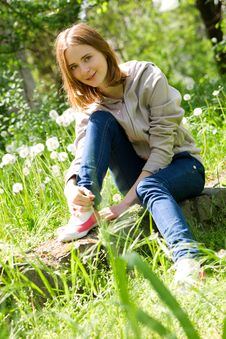 Free Beautiful Young Woman Sitting In Dandelions Royalty Free Stock Image - 14231036