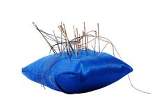 Pincushion With Needles And Threads Royalty Free Stock Photography