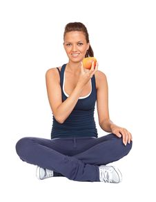 Gymnastics Girl With An Apple Sitting With Cross-l Stock Image