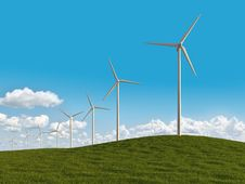 Free Electrical Windmills In A Meadow Royalty Free Stock Photography - 14235827
