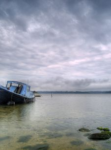 Old Abandoned Boat Floating Near The Shore Royalty Free Stock Photo