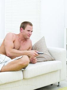 Free Muscular Man Watching TV Stock Photos - 14236943