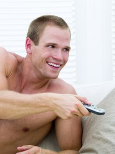 Free Muscular Man Watching TV Royalty Free Stock Images - 14236969