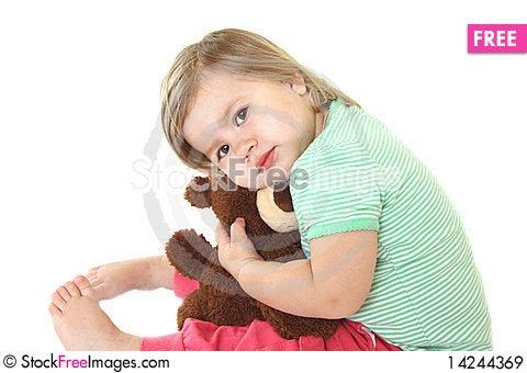 Cute baby girl with her teddy bear Stock Photo
