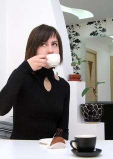 Free Nice Girl Drinking Coffee In A Cafe Stock Image - 14240631