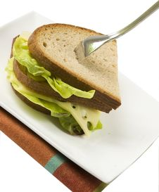 Dark Bread Sandwich With Standing Fork, Isolated Stock Photo