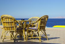 Table And Chairs Set At The Coastline Royalty Free Stock Photography