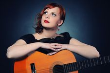 Free Redhead Woman With Guitar Stock Images - 14246474