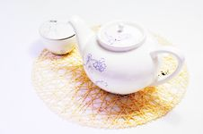 Free Teapot And Cup On The Mat Royalty Free Stock Photography - 14246597