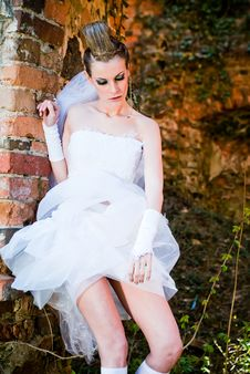 Free Bride By The Stone Wall Royalty Free Stock Photography - 14246667