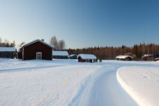 Free Small Wooden Houses In Winter. Stock Image - 14250201