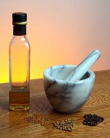 Mortar And Pestle, Olive Oil, And Spices Stock Photography