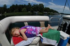 Free Girl Resting On Boat Royalty Free Stock Images - 14251619