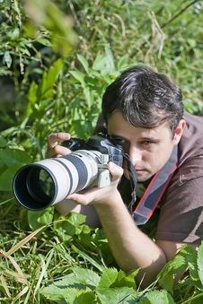 Free Young Bird Watcher With Photo Camera Stock Photos - 14252163