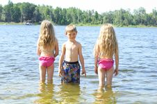 Free Little Boy With Friends In The Water Royalty Free Stock Images - 14253019