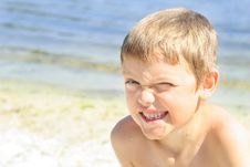 Cute Little Boy Winking At The Beach Stock Photo