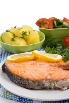 Grilled Salmon With Potatoes And Salad Royalty Free Stock Photography