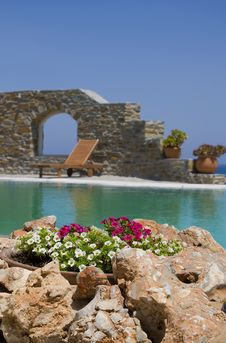 Free Stone Flower Beds Around The Pool With Sunbeds Stock Photography - 14256532