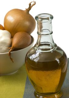 Bottle Of Olive Oil With Onion And Garlic Stock Photo