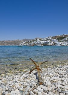 Old Anchor On The Shore Of The Bay Of Mykonos Stock Photo