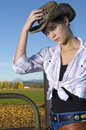 Free Cowgirl On Fence Royalty Free Stock Image - 14269686