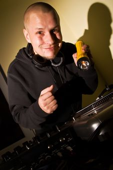 Free DJ With A Flashlight At The Turntables Stock Photography - 14262042