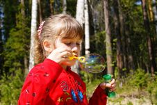 The Girl Inflates Soap Bubbles Stock Photos