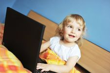 Free Little Girl With Laptop Stock Photo - 14266340