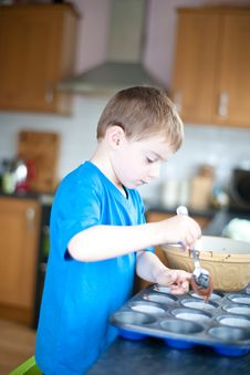 Free Young Boy Making Chocolate Cakes Royalty Free Stock Photos - 14266868