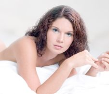 Soft Portrait Of Beautiful Woman On White Bed Stock Image