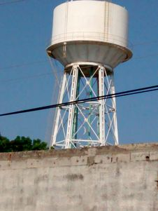 METALLIC WATER TANK FOR INDUSTRIAL USE ELEVATED AT GREAT HEIGHT Royalty Free Stock Image