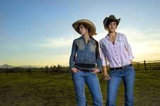 Free Twin Cowgirls In A Coral Stock Image - 14270101