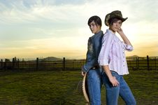 Free Twin Cowgirls In A Coral Royalty Free Stock Photography - 14270187