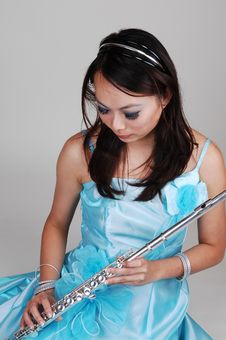 Free Chinese Girl In Dress With Flute. Stock Images - 14270734