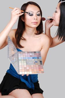 Two Chinese Girls Doing Makeup. Royalty Free Stock Images