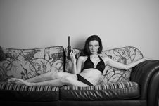 Free Young Attractive Female With A Gun On A Couch Stock Image - 14273931