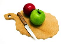 The Apples Lying On A Board For Cutting Royalty Free Stock Photo