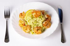 Risotto With Fried Prawns And Avocado Stock Photography