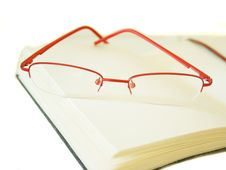 Free Notebook Made Of A Red Skin And Glasses Stock Image - 14280491