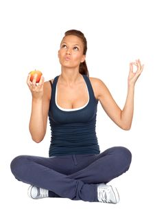 Gymnastics Girl With An Apple Sitting Royalty Free Stock Photography