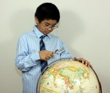 Free A Boy Examining A Globe Royalty Free Stock Photography - 14285037