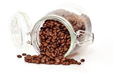 Free Coffee Beans Spilling Out Of A Cristal Jar Royalty Free Stock Image - 14287906